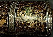 Trunk.  Japan, c. 1575-1625, Nanban lacquer ware.  The trunk is decorated with gold lacquer and inlaid mother-of-pearl.  This type of lacquer ware is call Nanban.  The Japanese used this word to refer to foreign traders in Japan - first the Portuguese and from 1609, also the Dutch.  The shape of the trunk and its scenes follow European models.  The mother-of-pearl bands imitate the metal mounts on a Western-style European chest.