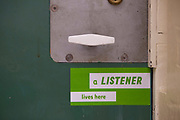 A Samaritans volunteer, also known as a listener, has a sticker on their cell door in case anyone needs to talk. HMP Kingston.
