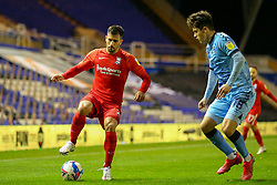 Birmingham City's Maxime Colin controls the ball, watched by Ryan Giles of Coventry City (on loan from Wolves)  - Mandatory by-line: Nick Browning/JMP - 20/11/2020 - FOOTBALL - St Andrews - Birmingham, England - Coventry City v Birmingham City - Sky Bet Championship