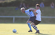 Lawrence Edwrads shields the ball during the FA Vase 1st Qualifying Round match between Worthing United and East Preston FC at the Robert Eaton Memorial Ground, Worthing, United Kingdom on 6 September 2015. The first home match for Worthing United since losing team mates Matthew Grimstone and Jacob Schilt in the Shoreham air show disaster.