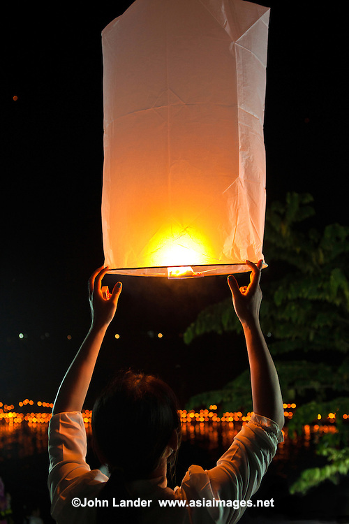 Lantern at Boun Awk Phansa - the last day of  Buddhist lent. It occurs in October, three lunar months after Khao Phansa. It is a day of celebrations, most notably the boat races held along the Mekong River.   On the first day at dawn, donations and offerings are made at temples around the country. In the evening candlelight processions are held around the temples and it is the celebration of lai heua fai or Loi ka thong, when everyone sends small lighted boats made of banana stems or banana leaves decorated with candles and flowers down the rivers.  .