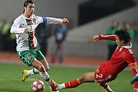 20100303: COIMBRA, PORTUGAL - Portugal vs China: International Friendly. In picture: Cristiano Ronaldo (Portugal) and Du Wei (China). PHOTO: CITYFILES