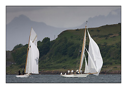 The Truant 1910 an 8 metre with Fyne a 1889  Gaff Cutter both off Cumbrae...Round the Cumbraes race to open the regatta. Light variable breeze and grey skies shrouded the fleet with a strong spectator fleet...* The Fife Yachts are one of the world's most prestigious group of Classic .yachts and this will be the third private regatta following the success of the 98, .and 03 events.  .A pilgrimage to their birthplace of these historic yachts, the 'Stradivarius' of .sail, from Scotland's pre-eminent yacht designer and builder, William Fife III, .on the Clyde 20th -27th June.   . ..More information is available on the website: www.fiferegatta.com . .Press office contact: 01475 689100         Lynda Melvin or Paul Jeffes
