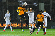 Jamille Matt (11) of Newport County heads the ball under the challenge of Adam Clayton (8) of Middlesbrough during the The FA Cup match between Newport County and Middlesbrough at Rodney Parade, Newport, Wales on 5 February 2019.