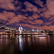 The London skyline, shot from the Southbank looking north including St Pauls cathedral and the millennium bridge over the river thames. Captured early evening sunset by photographer Stuart Freeman.