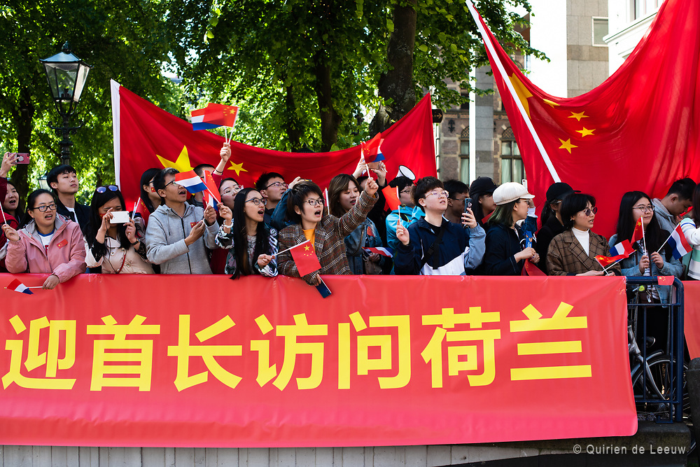 Chinese residents of The Hague cheer at China's vice president Wang Qishan who is visiting The Hague.