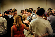 A bride and groom kiss during their reception at Phoenixville Country Club in Phoenixville, Pennsylvania.