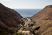 ST.Helena <br /> <br /> View of Jamestown, the only city in St.Helena Island.<br /> St. Helena island, part of the British Overseas Territory, measures just 6 by 10 miles and comprises 47 square miles of rocky coastline, colored desert, rippled pastureland and lush cloud forest. This speck of land is one of the most remote islands on earth.<br /> <br /> Since discovery in 1502, until the start of commercial flights in October 2017, the sea route had been the only way to reach St Helena. At its peak more than 1,000 ships a year visited on the way to and from India and the Far East via the Cape of Good Hope. That declined after 1869 with the opening of the Suez Canal.