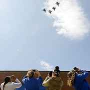 """Healthcare workers film on their phones as the Ohio Air National Guard's 180th Fighter Wing does a flyover in F-16s over Mercy Health St. Vincent Medical Center in Toledo on Wednesday, May 6, 2020. The event called """"Operation American Resolve"""" was the 180th's salute toOhio healthcare workers, first responders, military members and other essential personnel."""