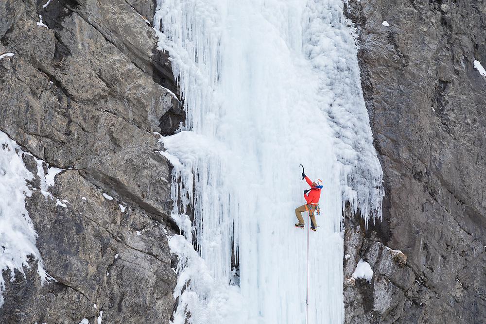 Jeff Mercier traversing across the ice climb R and D in Kananaskis, Alberta, Canada