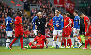 Emre Can of Liverpool sits after being tackled by Ross Barkley of Everton during the English Premier League match at Anfield Stadium, Liverpool. Picture date: April 1st 2017. Pic credit should read: Simon Bellis/Sportimage