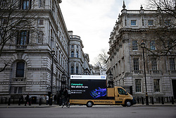 © Licensed to London News Pictures. 20/03/2020. London, UK. An ad van drives past Downing Street displaying a message advertising the latest public health advice on the Coronovirus pandemic. Photo credit: Rob Pinney/LNP