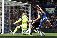 Jamie Vardy of Leicester City takes a shot at goal but sees it saved by Thibaut Courtois, the Chelsea goalkeeper. Barclays Premier league match, Chelsea v Leicester city at Stamford Bridge in London on Sunday 15th May 2016.<br /> pic by John Patrick Fletcher, Andrew Orchard sports photography.