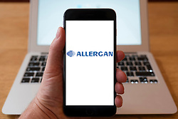 Using iPhone smartphone to display logo of Allergan  global pharmaceutical company