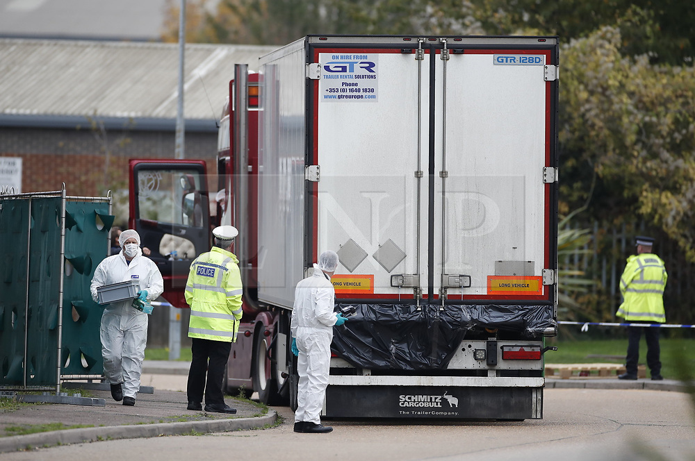 © Licensed to London News Pictures. 23/10/2019. Grays, UK. Police work at the rear of the lorry  at Waterglade Industrial Park in Grays, Essex where the bodies of 39 people have been found in a lorry container. The driver, a 25-year-old-man from Northern Ireland, has been arrested on suspicion of murder. . Photo credit: Peter Macdiarmid/LNP