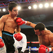 ORLANDO, FL - OCTOBER 04: Christopher Diaz of Puerto Rico (R)  catches Francisco Camacho of Mexico with a right cross during a professional featherweight boxing match at the Bahía Shriners Auditorium & Events Center on October 4, 2014 in Orlando, Florida. (Photo by Alex Menendez/Getty Images) *** Local Caption *** Christopher Diaz; Francisco Camacho