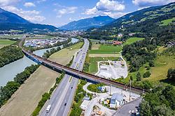 THEMENBILD, Für die Güterzüge auf der Brennerachse wurde 1994 eine grosszügig angelegte und doppelspurige Umfahrung in Betrieb genommen. Herzstück dieser Strecke ist der 12,7 Kilometer lange Inntal-Tunnel. Hier im Bild: Eisenbahnbrücke über den Inn und die Inntalautobahn A12. Fritzens, am Dienstag 23. Juni. 2020 // In 1994, a spacious, double-lane bypass was put into operation for the freight trains on the Brenner axis. The heart of this route is the 12.7-kilometer Inntal tunnel. Fritzens, on Tuesday June 23rd. 2020. EXPA Pictures © 2020, PhotoCredit: EXPA/ Johann Groder