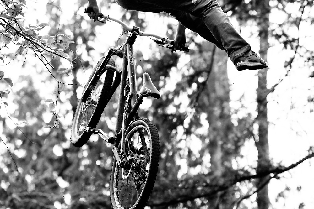 Zaid Elgawarsha takes off for foot free air on a private trail in Bellingham Washington.
