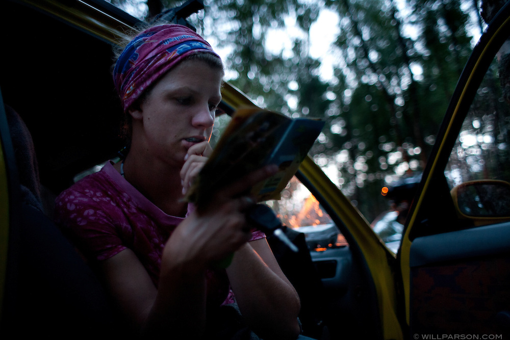 Bones reads in the car at a campsite on Lithuania's Curonian Spit, a tourist destination in the Baltic Sea.