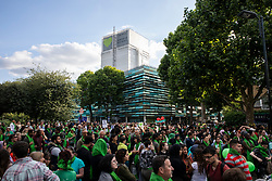 © Licensed to London News Pictures. 14/06/2018. London, UK. Thousands of people gather at the foot of Grenfell Tower to join a silent procession to mark the first anniversary of the Grenfell Tower Fire in which 72 people were killed. Grenfell Tower caught fire on the night of June 14, 2017 after a small blaze started in one of the flats which spread rapidly up the outside of the 24-floor tower block. A public inquiry is currently underway. Photo credit: Rob Pinney/LNP