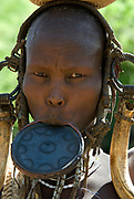 Woman with lip plate wearing head gear, Mursi Tribe, Mago National Park, Lower Omo Valley, Ethiopia, portrait, person, one, tribes, tribal, indigenous, peoples, Southern, ethnic, rural, local, traditional, culture, primitive