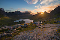 Morning sun shines over mountains above Fagerådalen valley, Moskenesøy, Lofoten Islands, Norway