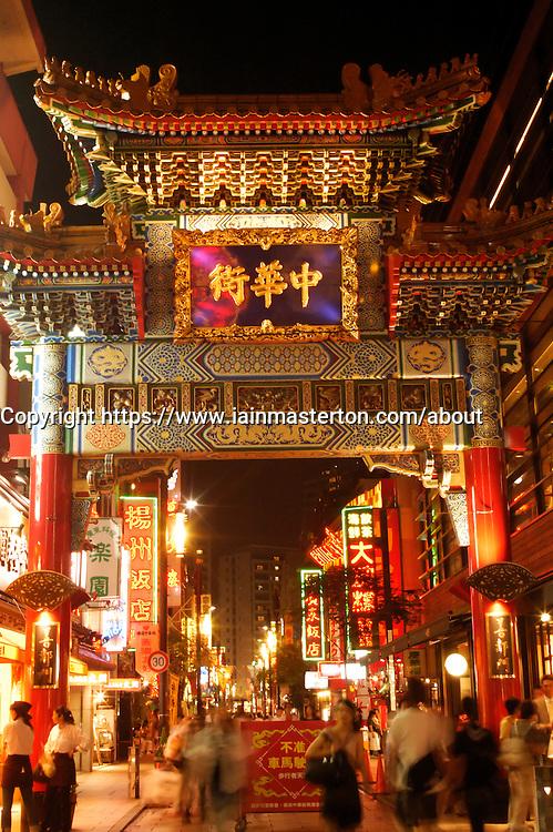 Night view of ornate traditional gate at Chinatown in Yokohama Japan