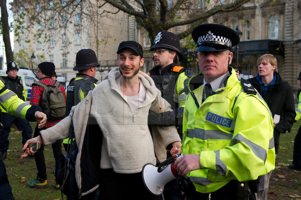 © under license to London News Pictures.  24/11/2010 A man is moved along by the police in Bristol today (Wednesday) as students march through the centre of Bristol. Demonstrations all over the UK are taking place to protest against proposed higher education fees. Credit should read: David Hedges/London News Pictures