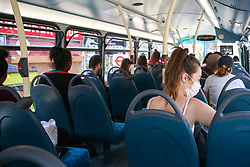 © Licensed to London News Pictures. 01/06/2020. London, UK. Passengers travelling on a London bus as lockdown restrictions are eased in England after ten weeks of the coronavirus lockdown. Photo credit: Dinendra Haria/LNP