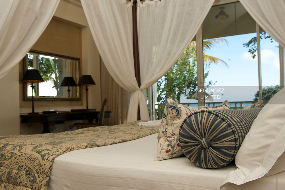 Mauritius Island. King size bed in a room with views at Le Telfair Hotel