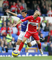 Photo: Paul Thomas.<br /> Everton v Middlesbrough. The Barclays Premiership.<br /> 06/11/2005.<br /> <br /> Everton's Tim Cahill tries to tackle Gaizka Mendieta.