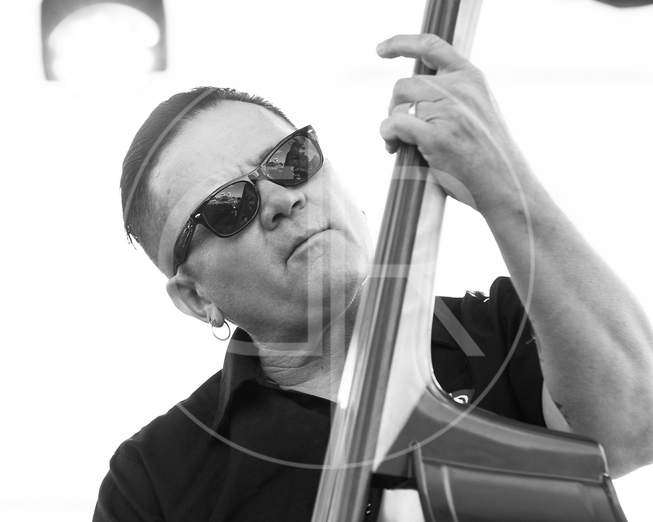 BALTIMORE United States - September 14, 2013: Jimbo Wallace of The Reverend Horton Heat performs at The Shindig, in Baltimore's historic Carroll Park
