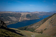 Thirlmere reservoir surrounded by the beautiful green valley of Wythburn and Armboth Fells taken from the western side of Helvellyn mountain, Lake District, Cumbria, UK.  The reservoir is in the site of a natural lake within the Lake District National Park.