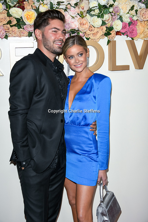 DYLAN BARBOUR (L) and HANNAH GODWIN attend the 3rd Annual #REVOLVEawards at Goya Studios in Los Angeles, California