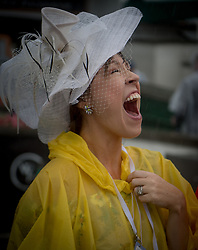 May 5, 2018 - Louisville, Kentucky, U.S. - A women react to heavy rain falling on Kentucky Derby Day at Churchill Downs in Louisville, Kentucky, Sunday, May 5, 2018. (Credit Image: © Bryan Woolston via ZUMA Wire)