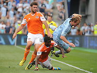 Football - Major League Soccer - Houston Dynamo at Sporting KC - The Sporting KC and the Houston Dynamo played to a 1-1 tie in regulation time at Sporting KC Park in Kansas City, Kansas, USA. Sporting KC defender Seth Sinovic (15) flies out of bounds after he collides with Houston Dynamo forward Will Bruin (12) and Houston Dynamo defender Kofi Sarkodie (8) in the first half..