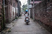 October, 1 2015. Kieu's wife drives the kids to their grandparents near Hanoi, Vietnam