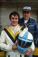 Sir Jack Brabham,Australian and 3 times winner of the World Formula One Championship seen with his son Gary, a professional racing driver and a winner of the British Formula 3000 Championship. Photographed in the UK in October 1984. Photograph by Terry Fincher
