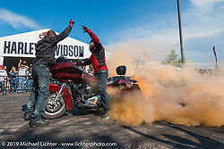 Stunt Riders Jason Thompson and Cole Freeman at the Harley-Davidson downtown Sturgis display during the annual Black Hills Motorcycle Rally. SD, USA. August 9, 2014.  Photography ©2014 Michael Lichter.
