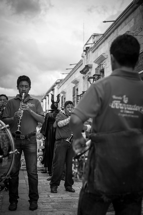 A marching band performs on a main street in Oaxaca, part of the festivities as people celebrate the Day of the Dead (Día de los Muertos)