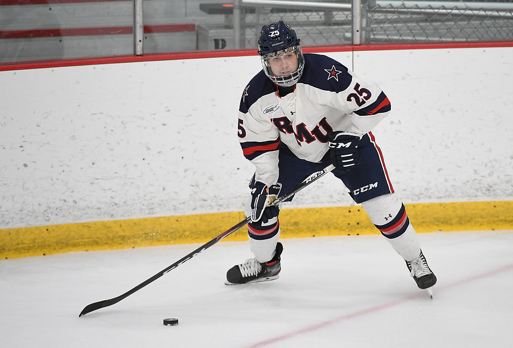 PITTSBURGH, PA - NOVEMBER 21: Bradley Stonnell #25 of the Robert Morris Colonials skates with the puck in the second period during the game against the Alabama-Huntsville Chargers at Clearview Arena on November 21, 2020 in Pittsburgh, Pennsylvania. (Photo by Justin Berl/Robert Morris Athletics)