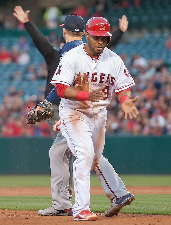 The Angels' Gregorio Petit claps after being awarded third base during a run down in the second inning against the Minnesota Twins Monday at Angel Stadium.<br /> <br /> ///ADDITIONAL INFO:   <br /> <br /> angels.0614.kjs  ---  Photo by KEVIN SULLIVAN / Orange County Register  -- 6/13/16<br /> <br /> The Los Angeles Angels take on the Minnesota Twins Monday at Angel Stadium.