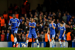 Chelsea Forward Demba Ba (SEN) and Defender Ashley Cole (ENG) look dejected after Basel get their second goal during the second half of the match - Photo mandatory by-line: Rogan Thomson/JMP - Tel: 07966 386802 - 18/09/2013 - SPORT - FOOTBALL - Stamford Bridge, London - Chelsea v FC Basel - UEFA Champions League Group E