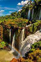 Rainbow, Iguazu Falls (Iguacu in Portugese), on the border of Brazil and Argentina. It is one of the New 7 Wonders of Nature and is a UNESCO World Heritage Site. There are 275 waterfalls total which make up the largest waterfalls in the world. This photo is on the Argentina side of the Falls.