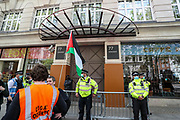 """London, United Kingdom, May 11, 2021: Pro-Palestinian demonstrators are gathered outside an Israeli international defence electronics company """"Elbit System"""" in central London on Tuesday, May 11, 2021 — following the killing of at least 24 Palestinians in Israeli air raids on the besieged Gaza Strip. Demonstrators also continue to show their opposition against planned evictions of Palestinian families in the Sheikh Jarrah neighbourhood of East Jerusalem. This is the second week of ongoing protests to be held across England. (Photo/ Vudi Xhymshiti)"""