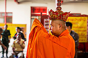 "09 AUGUST 2014 - BANGKOK, THAILAND:     Vietnamese Buddhist monks lead a service for Ghost Month at the Ruby Goddess Shrine in the Dusit section of Bangkok. The seventh month of the Chinese Lunar calendar is called ""Ghost Month"" during which ghosts and spirits, including those of the deceased ancestors, come out from the lower realm. It is common for Chinese people to make merit during the month by burning ""hell money"" and presenting food to the ghosts. At Chinese temples in Thailand, it is also customary to give food to the poorer people in the community.    PHOTO BY JACK KURTZ"