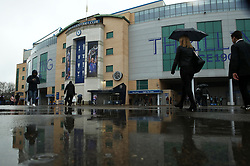 Fans in the rain outside Stamford Bridge before the game