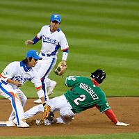 15 March 2009: #2 Edgar Gonzalez slides as #8 Keunwoo Jeong of Korea tags him during the 2009 World Baseball Classic Pool 1 game 2 at Petco Park in San Diego, California, USA. Korea wins 8-2 over Mexico.