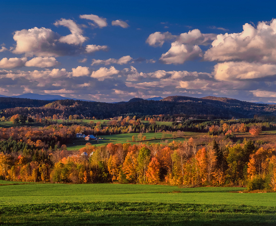 Winooski River Valley, farms, fields, and mountains in fall, blue sky & clouds, Cabot, VT