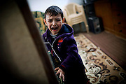 Maath, 6, a child suffering from a shortage of brain cells and a mental disability, is crying in his home in Fallujah, Iraq. The parents and their relatives have no history of birth defects.